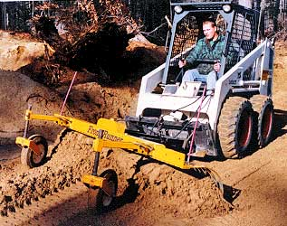 Grader / rake on a rental skid steer