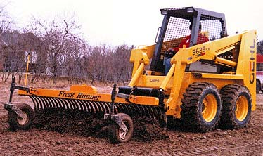 Grader / rake on a Gehl skid steer.